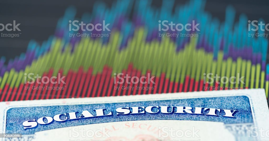 USA Social Security Card on graphs of income for retirement stock photo