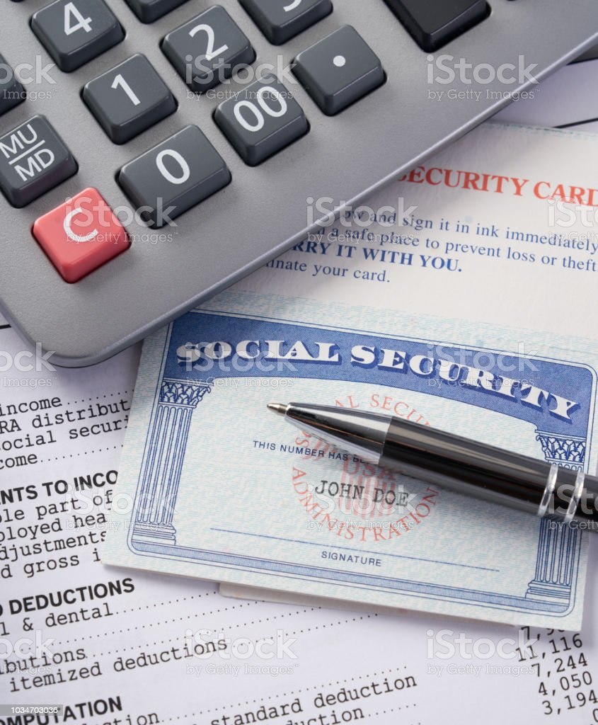 Social Security Card On Irs Tax Document With Calculator