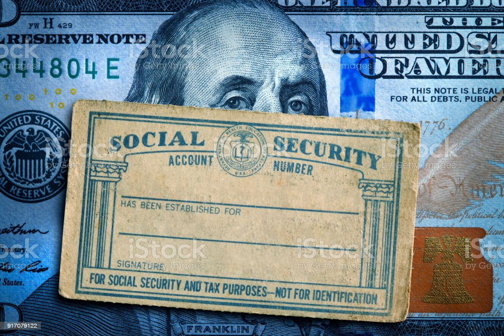 Social Security Card On Top Of A $100 Bill stock photo