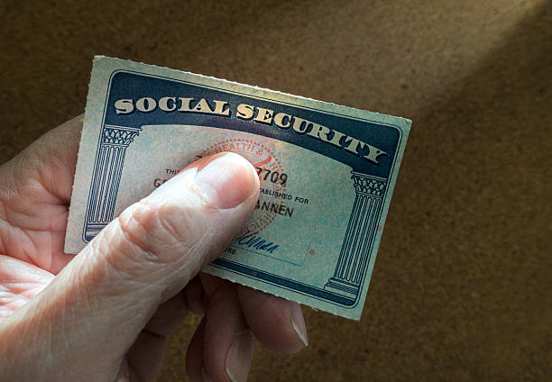 social security card man holding social security card identity theft stock pictures, royalty-free photos & images