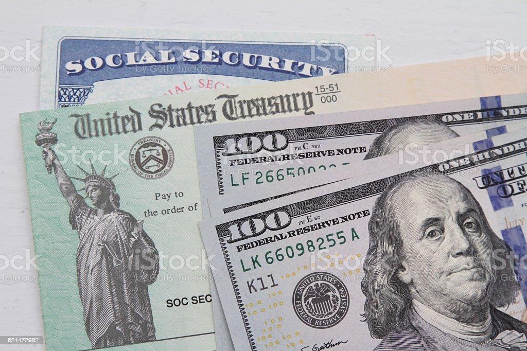 Social security card, Treasury check and USA 100 dollar bills stock photo