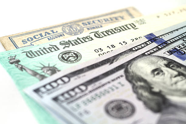 social security card, treasury checks and hundred dollar bills - social security check stock photos and pictures