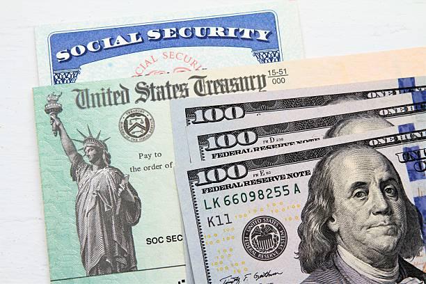Social Security card, Treasury checks and hundred dollar bills stock photo