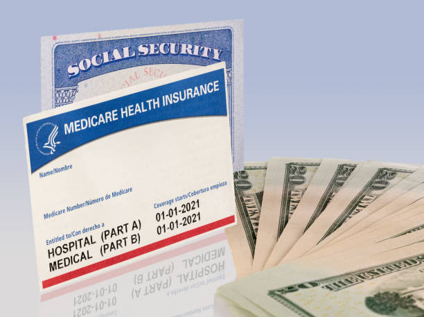 USA social security card with medicare and US dollars to illustrate budget crisis stock photo