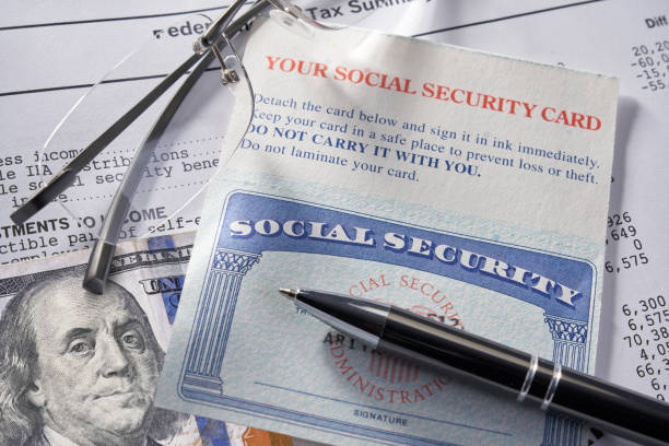 Social Security Card with money pen and glasses: $100 dollars stock photo
