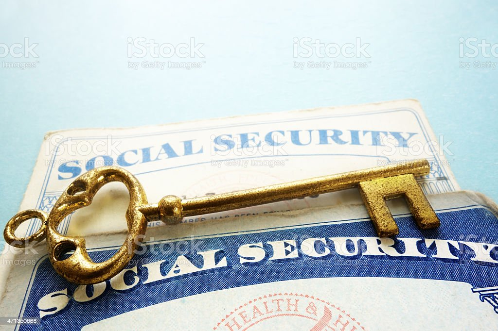 Social Security cards and key stock photo