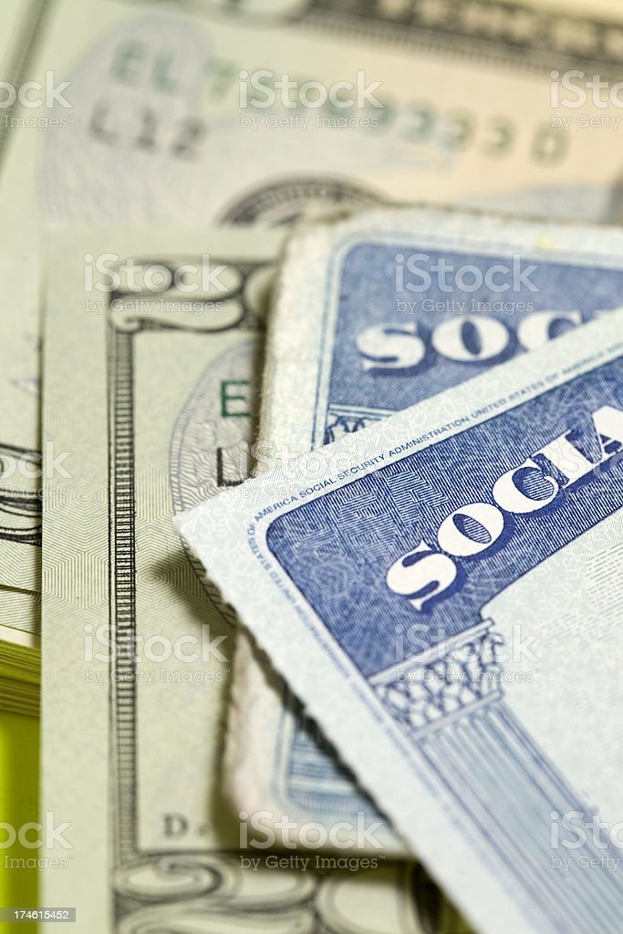 Social security cards and money royalty-free stock photo