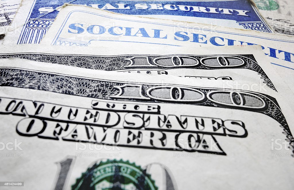 Social Security cards and money stock photo