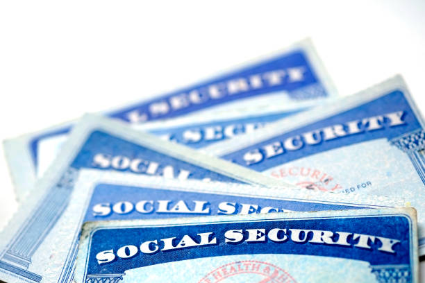 Social Security Cards for identification Social Security Cards for identification and retirement USA social security stock pictures, royalty-free photos & images