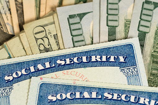 Usa Social Security Cards Laid On Dollar Bills Stock Photo - Download Image Now