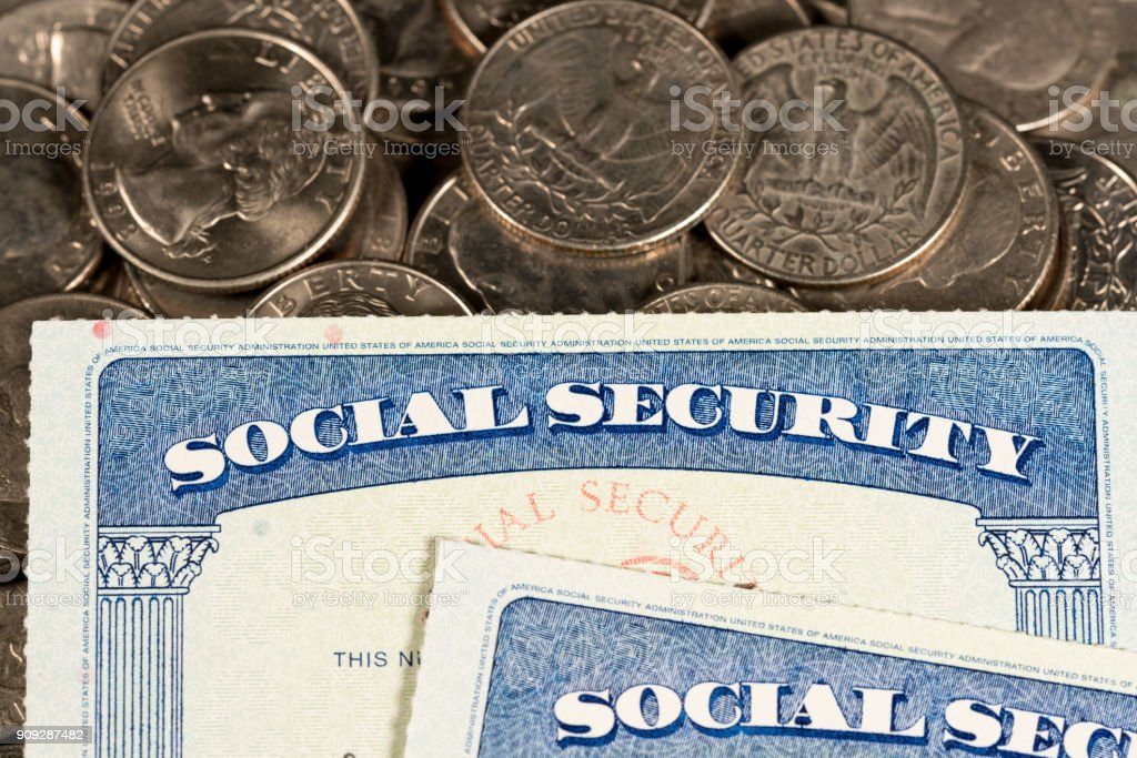 USA Social security cards laid on quarter coins stock photo