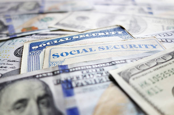 Social Security cards Social Security cards and assorted cash social security stock pictures, royalty-free photos & images