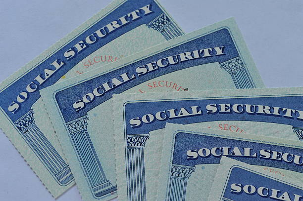 Social Security Cards Close-up of American social Security cards. social security stock pictures, royalty-free photos & images