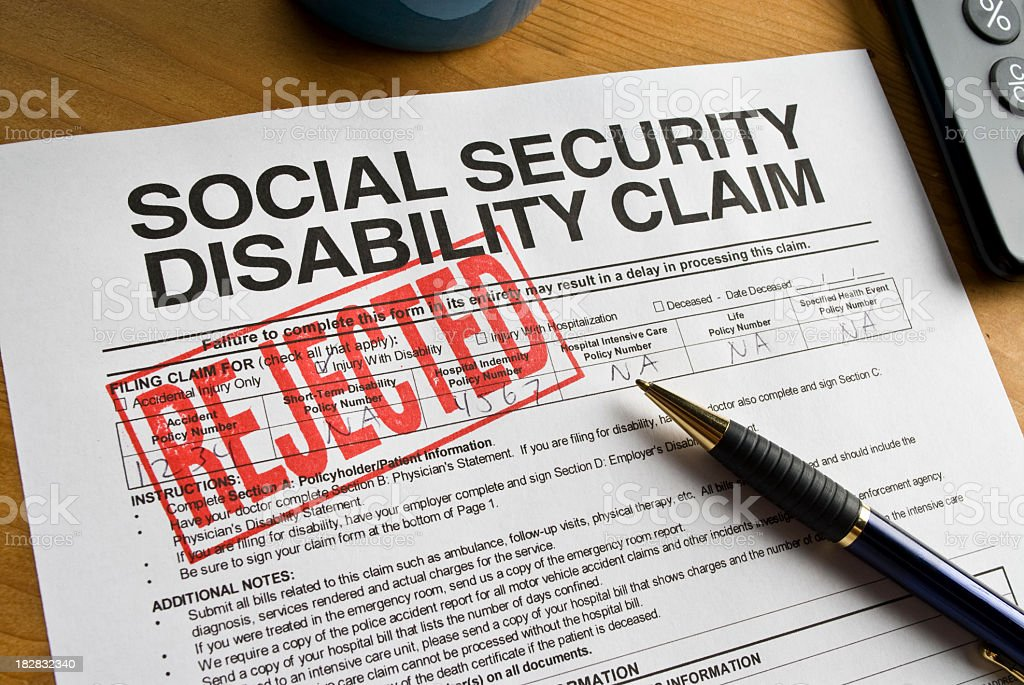 A social security disability claim form stamped REJECTED stock photo