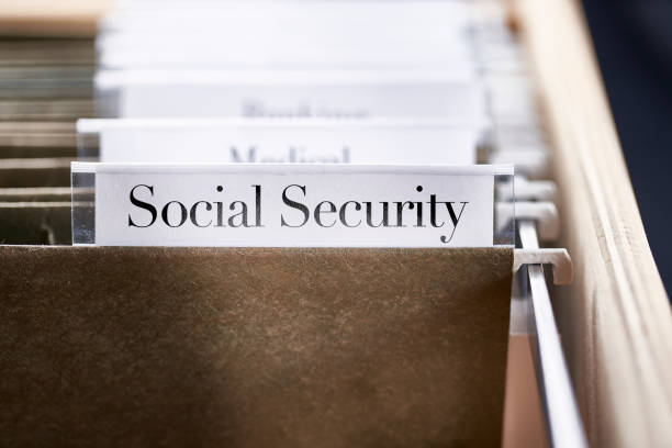 Social Security: Files and folders in desk drawer with labels and tabs: Home office management stock photo