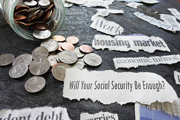 social security newspaper headlines - social security check stock photos and pictures