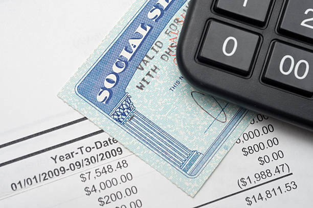 Social security A calculator, social security, and financial statement. social security stock pictures, royalty-free photos & images