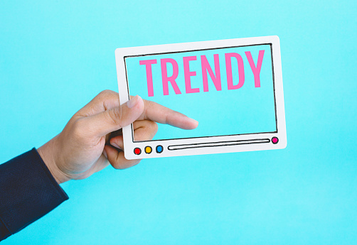 1125605742 istock photo Social trendy and online marketing concepts with male hand holding fram of video movie and text on blue color background 1144400049
