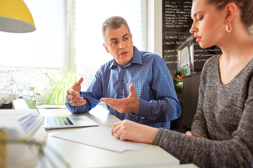 Social Worker Discussing Problems With Student Stock Photo - Download Image Now