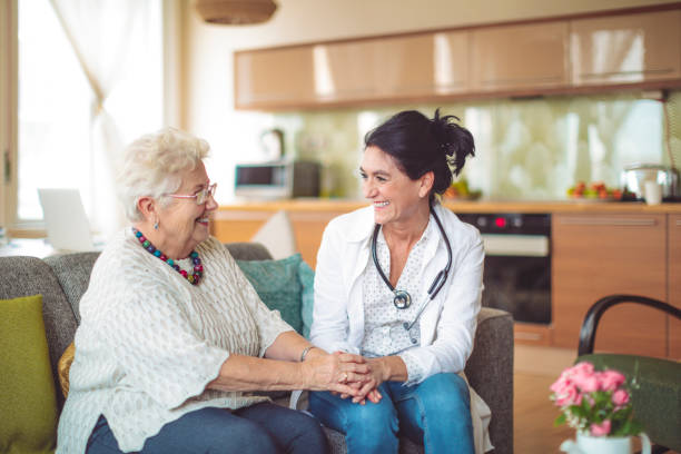 Social worker is visiting a senior woman Social worker is visiting a senior woman visit stock pictures, royalty-free photos & images