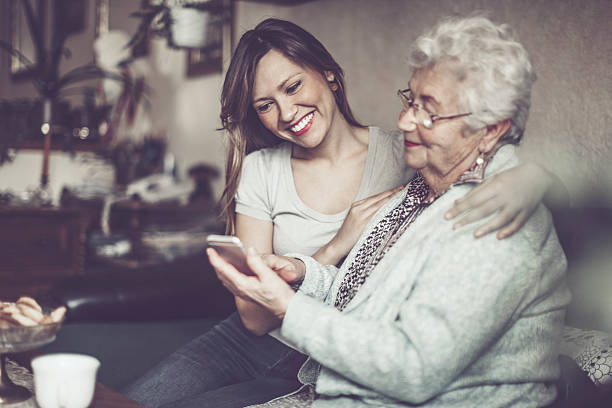 social worker is visiting a senior woman - granddaughter and grandmother stock photos and pictures