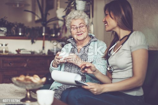 istock Social worker is visiting a senior woman 637115794