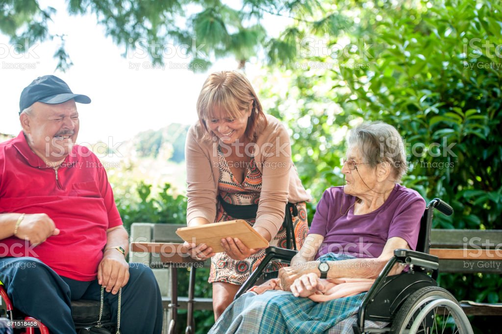 Social Worker Showing To Seniors In The Retirement Community...