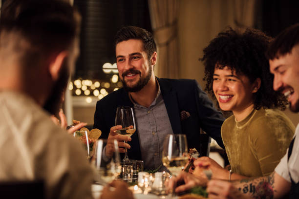 socialising over a meal - after work stock photos and pictures