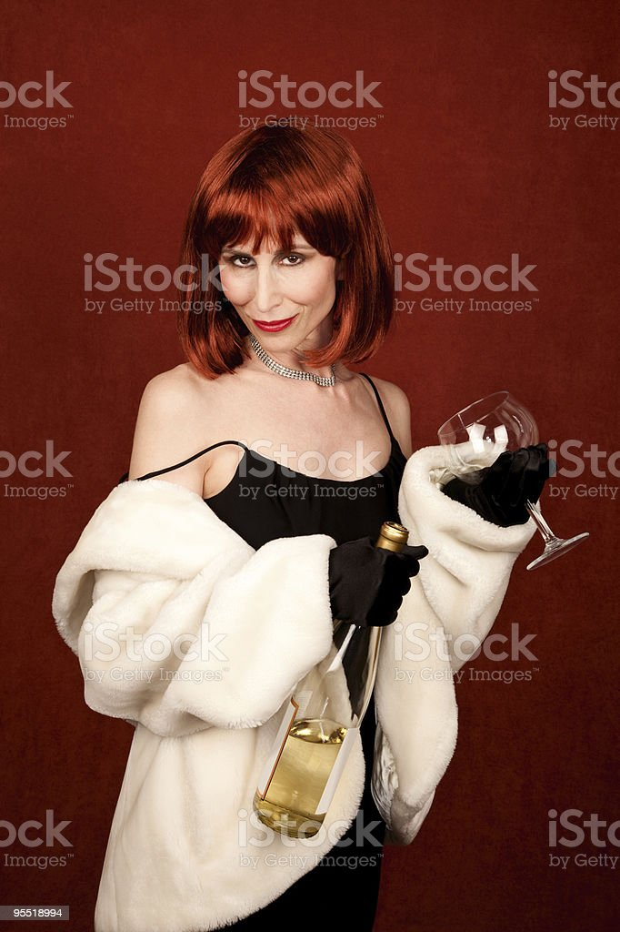 Socialite with brassy red hair and wine bottle royalty-free stock photo