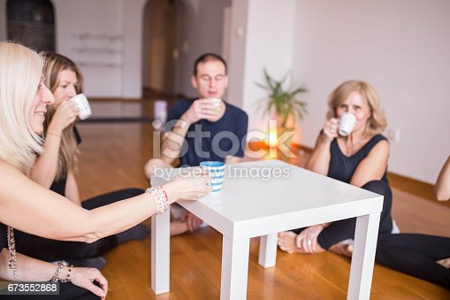 istock Socializing after class of yoga 673552868