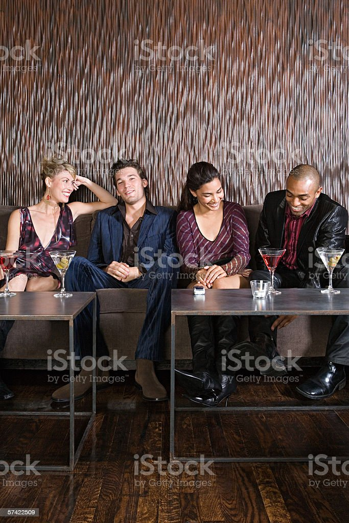 Socializing in a cocktail bar stock photo