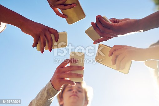 649172938istockphoto Socializing in the age of the smartphone 649172904