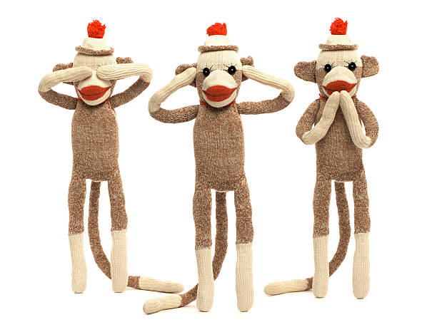 "Sock Monkeys Vintage sock monkeys in the classic ""see no evil, hear no evil, speak no evil"" pose. Set against a pure white background. hear no evil stock pictures, royalty-free photos & images"