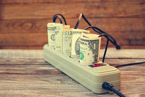 Socket And Money Concept Of Energy Savings Toned Image Stockfoto und mehr Bilder von Ausrüstung und Geräte