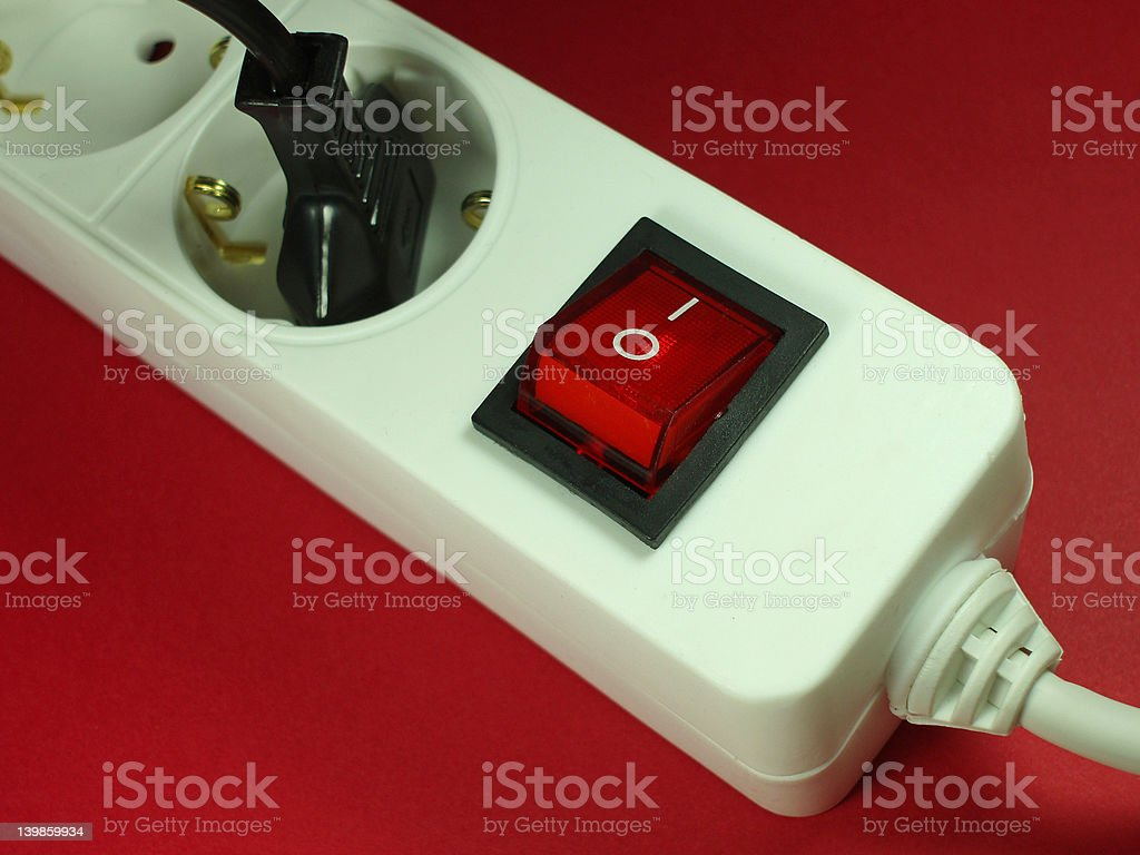 socket in front of red background stock photo