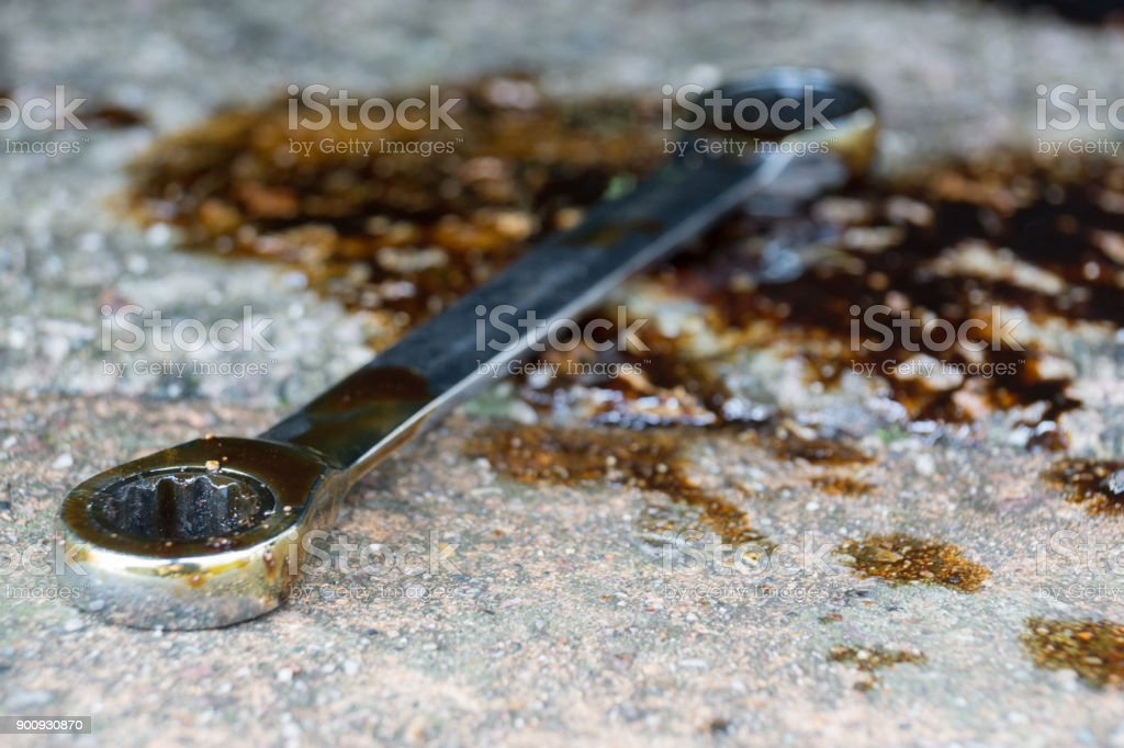 A socket wrench in oil stock photo
