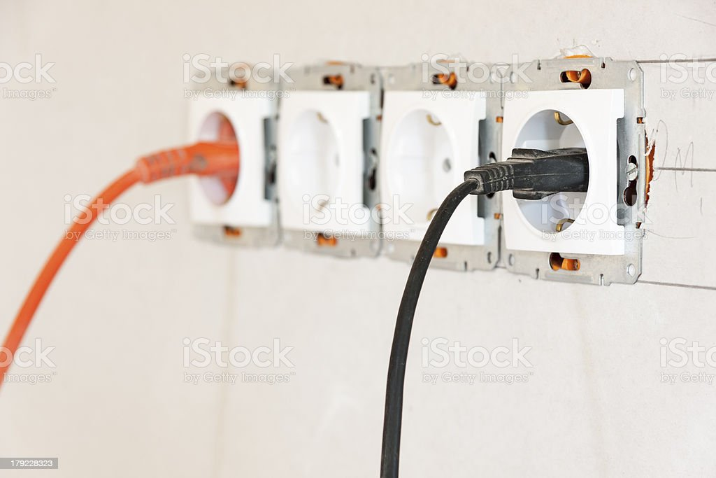 Sockets in a cyproc wall royalty-free stock photo