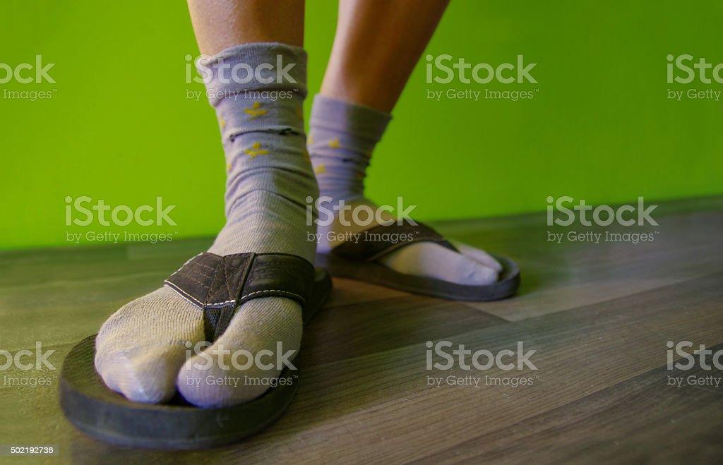 Socks in sandals stock photo