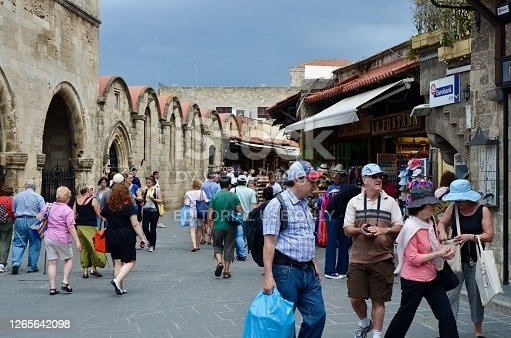 Rhodes, Greece - May 16, 2012: Socrates market street in Old Rhodes Town. The street is lined with shops, restaurants, and hundreds of tourists and vacationers.