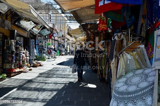 Rhodes, Greece - May 23, 2012: Socrates market street in Old Rhodes Town. The street is lined with shops, restaurants, and normally hundreds of tourists and vacationers.