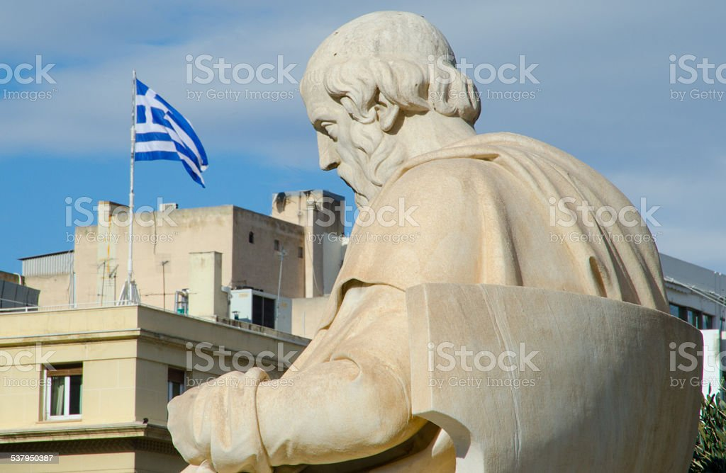 Socrates statue with Greek flag stock photo