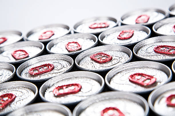 Soda cans lined up with condensation on top stock photo