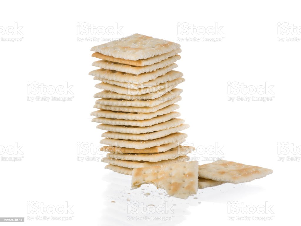 Soda crackers single stack half heaten isolated on white background - foto de acervo
