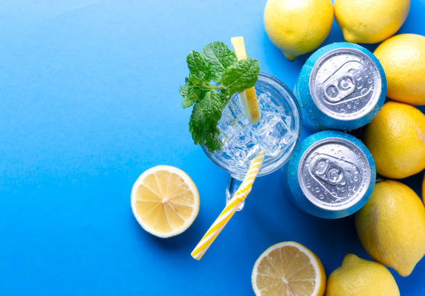 Soda drink with lemon and aluminium cans stock photo