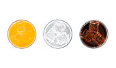 Top view of glasses of orange soda, lemon lime soda and cola drinks with ice isolated on white
