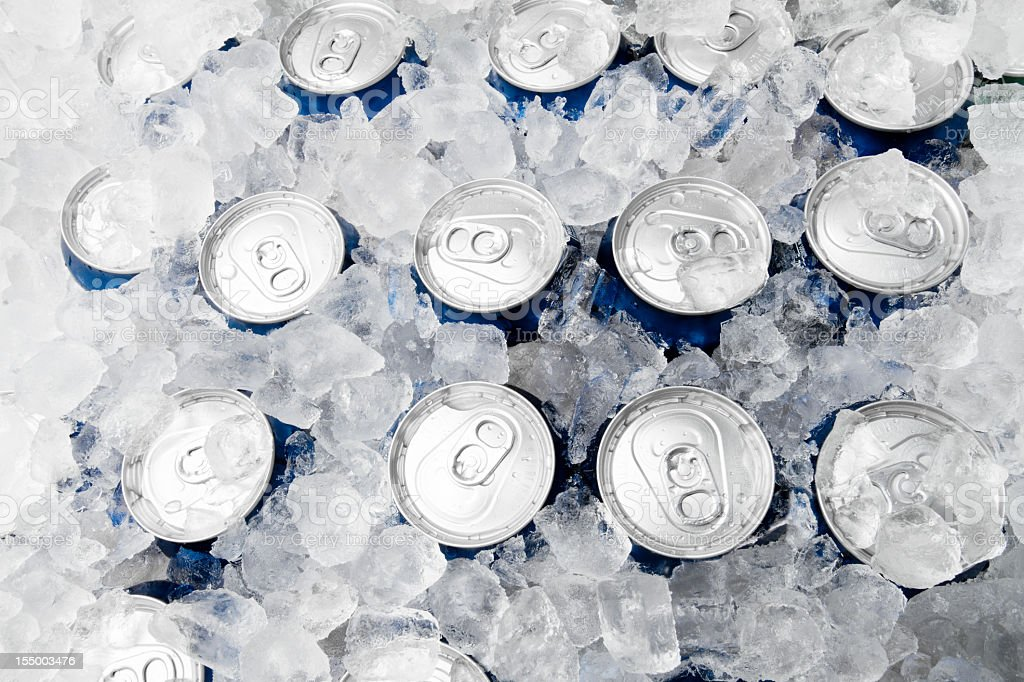 Soda or Beer Cans on Ice stock photo