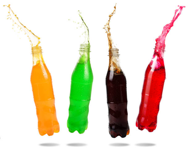 soda pop splashing - bottle soft drink foto e immagini stock