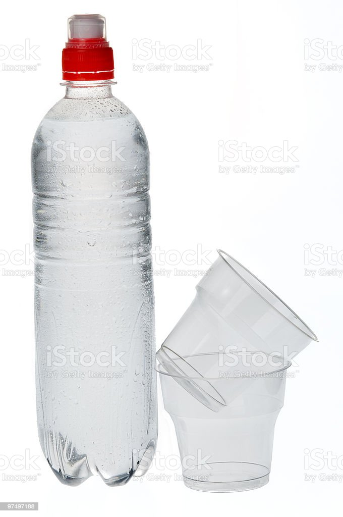 Soda water bottle with plastic glass royalty-free stock photo