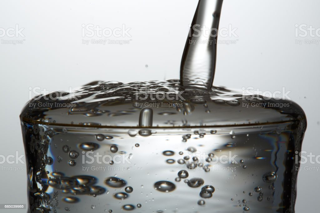 Soda water  Soda water on glass with bubble stock photo