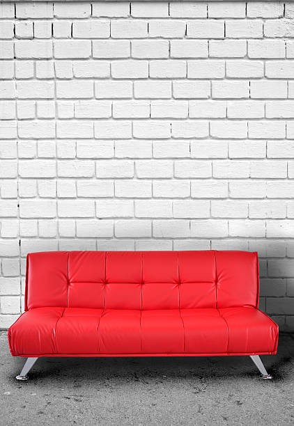 ... Sofa against brick wall. stock photo